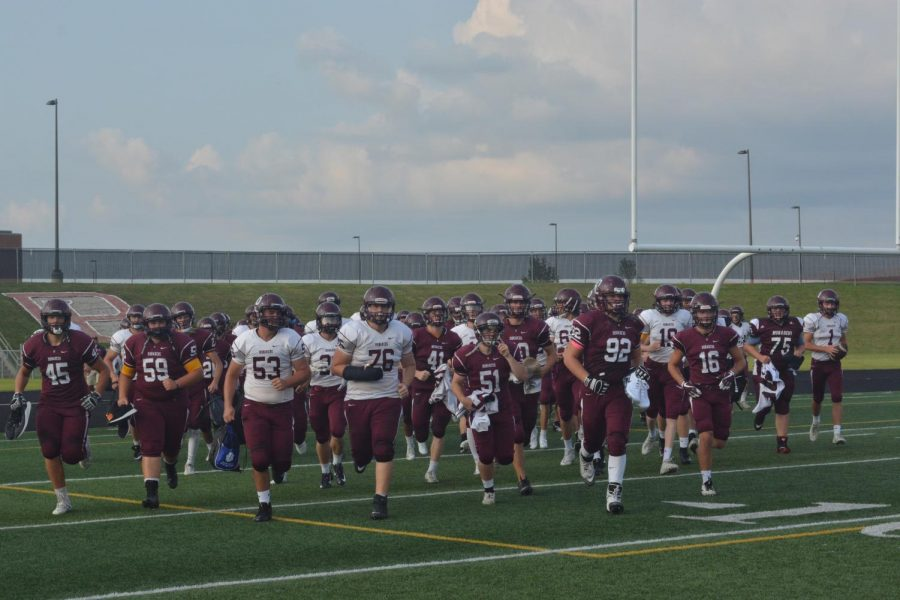 The Monarch football team enters the field for the first time in 2018 for the Maroon vs. White scrimmage.