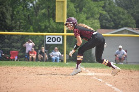 Sophomore Mia Jarecki gets into stance at first base, ready to advance.