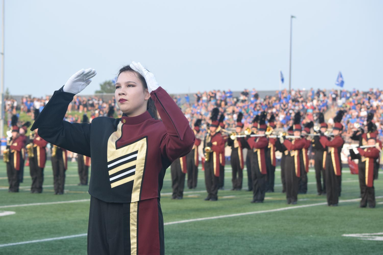 Junior drum major Amy Roach directs the band through pregame.