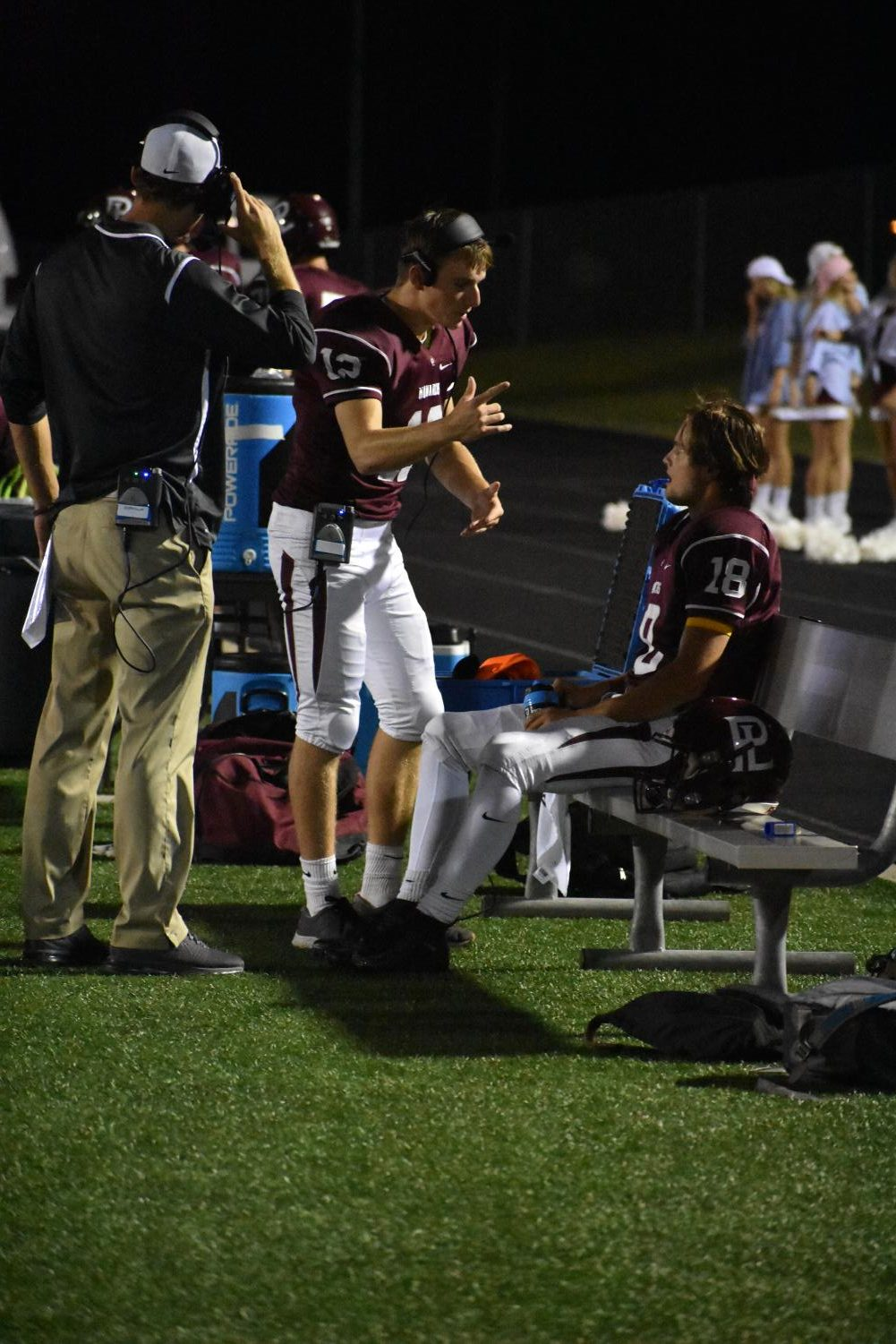 Conner Barnett gives some pointers to Logan Anderson during the game against Westside.