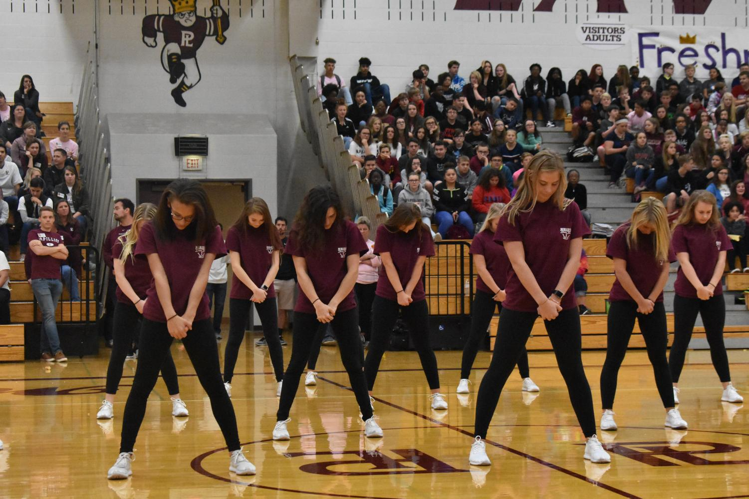 Dance Team getting in stance for their performance at the Homecoming pep rally.