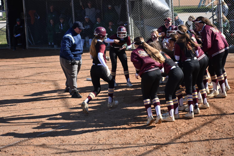 The PLHS Softball team celebrates a home run by sophomore Mia Jarecki.
