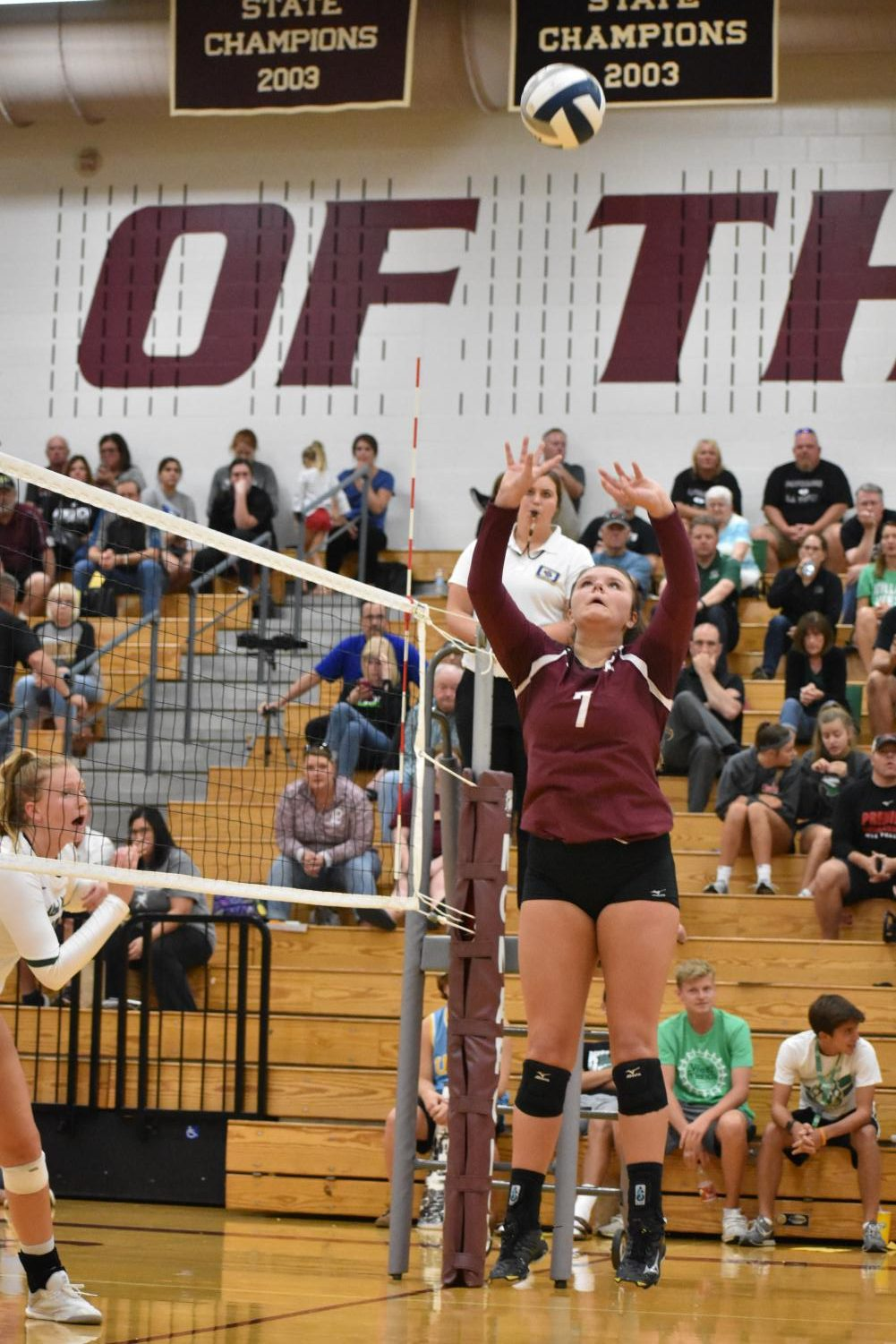 Junior setter Brooklyn Schram sets the ball against Millard West on Aug. 30. The monarchs fell to the Wildcats in four sets.
