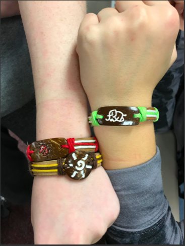 Student council members try on the Yuda Bands when they first come to PLHS.