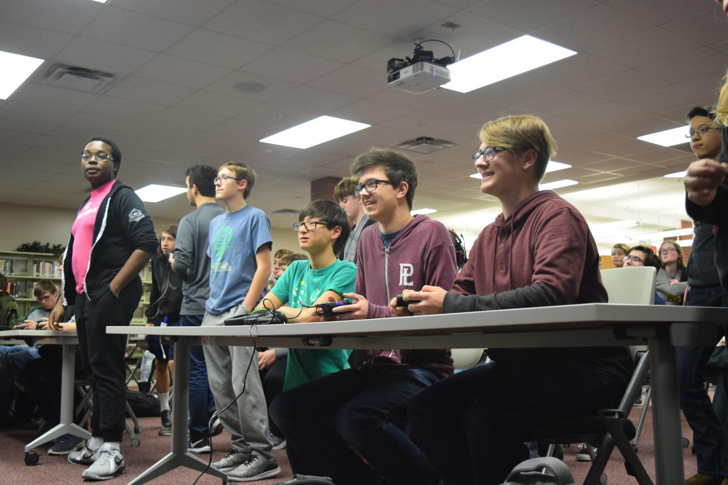 Senior Dylan Rossbach and Sophomore Sebastian MacNabb play a heated battle in the new Smash Bros. game. This was only one of several games that ended in shocked faces and applause.