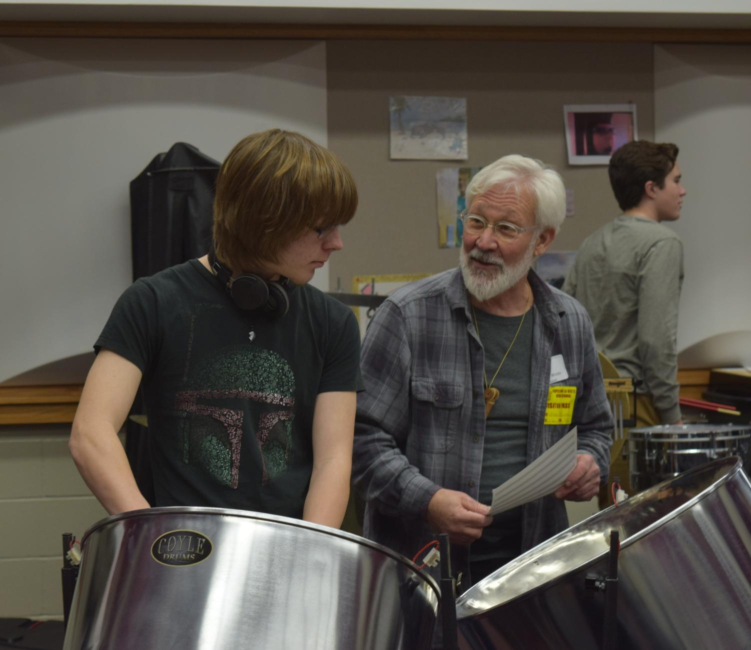 Gulizia works with junior Jake Lumm on the steel drum. The percussion class worked on a piece with various exotic drums.