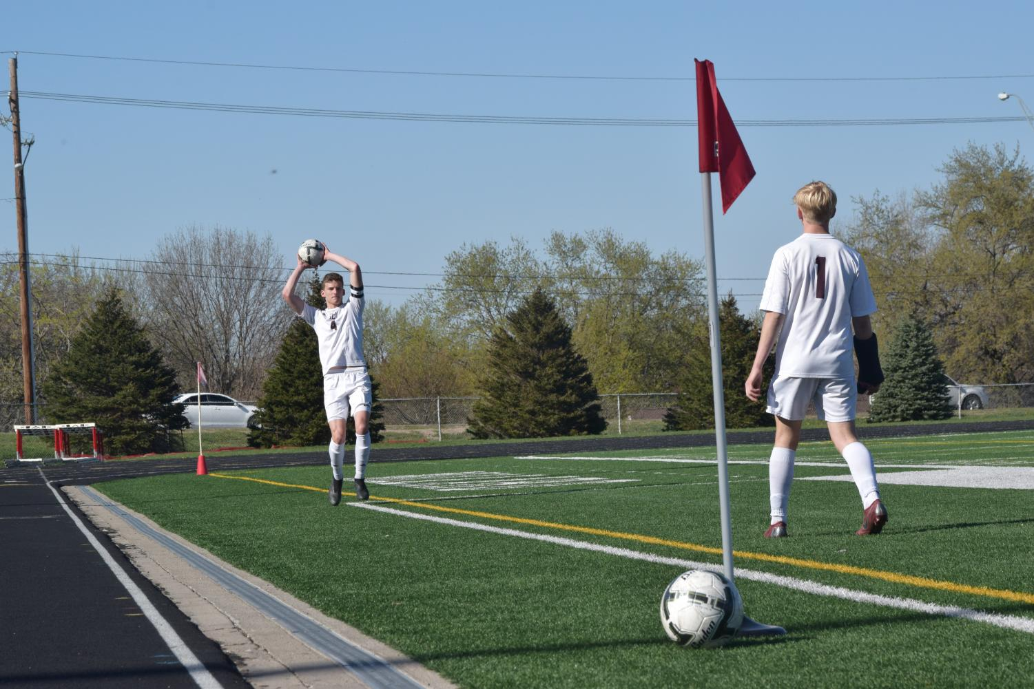 Junior+Josh+Jones+throws+in+the+ball+during+the+soccer+game+against+Millard+South.