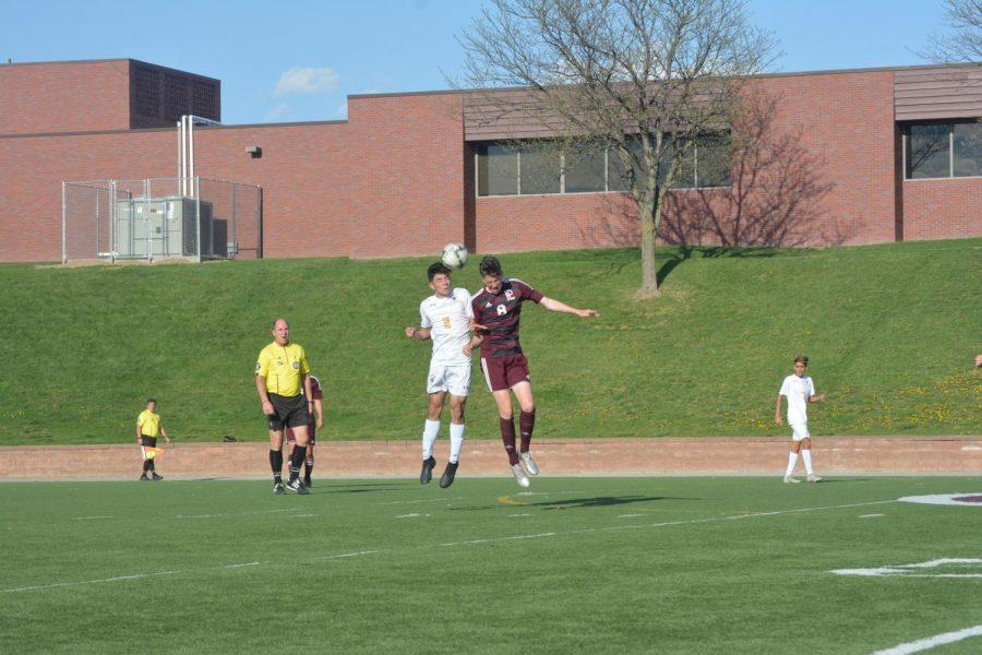 Junior+Logan+Dixon+attempts+to+head+the+ball.