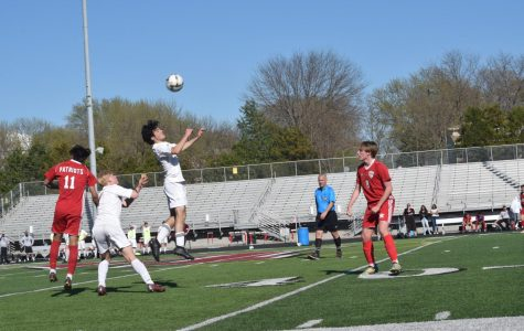 Junior Jackson Waldron heads the ball.