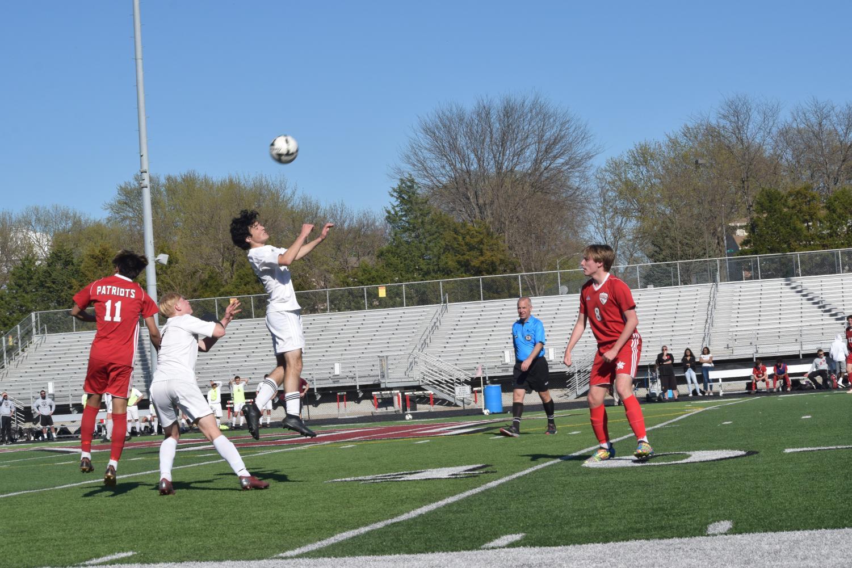 Junior Jackson Waldron heads the ball.
