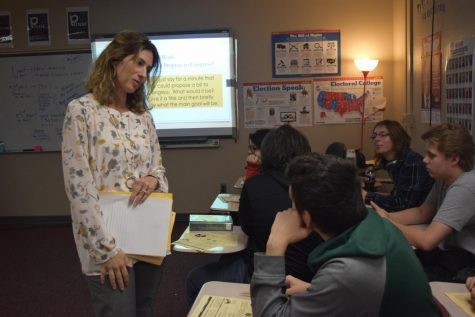 Mrs. Hubert talks to students about the process of passing legislative bills in the United States.