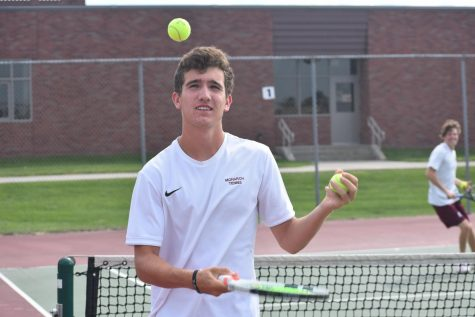 Neil is able to juggle both tennis and academics equally