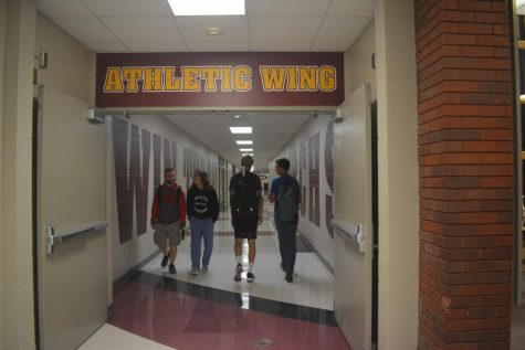 Students enjoy the new artwork and walk down the athletic and fine arts wings.