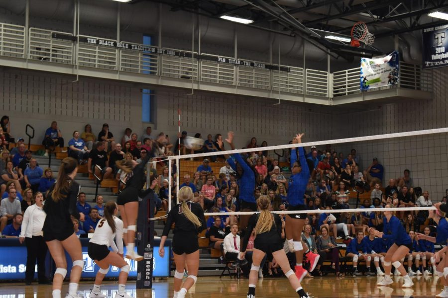 Senior Chole Paschal attacks during the Papillion LaVista South volleyball game.