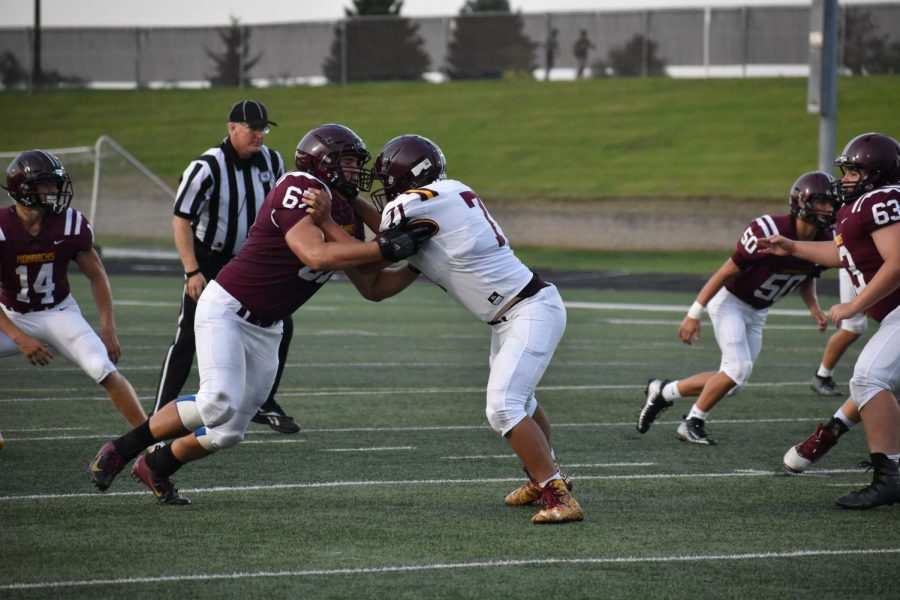 Senior, Wolfe Bonewall Blocks Senior, Matthew Schwartz during the Maroon and White scrimmage.
