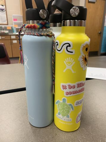 A basic VSCO girl trend is having a Hydro Flask with stickers, hair ties and friendship bracelets attached.