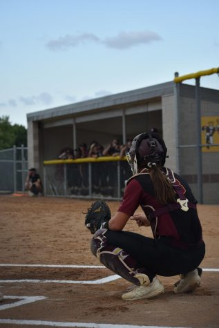 Brooke Dumont on Papillion's home field looks toward the dugout to receive signs to set up for the next pitch.