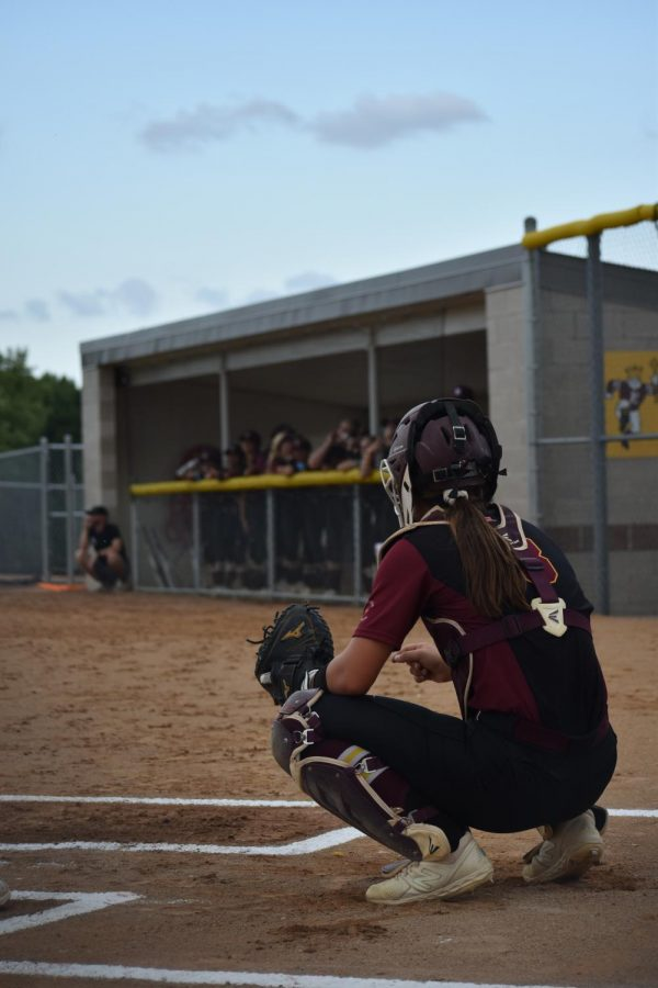 Brooke+Dumont+on+Papillion%27s+home+field+looks+toward+the+dugout+to+receive+signs+to+set+up+for+the+next+pitch.