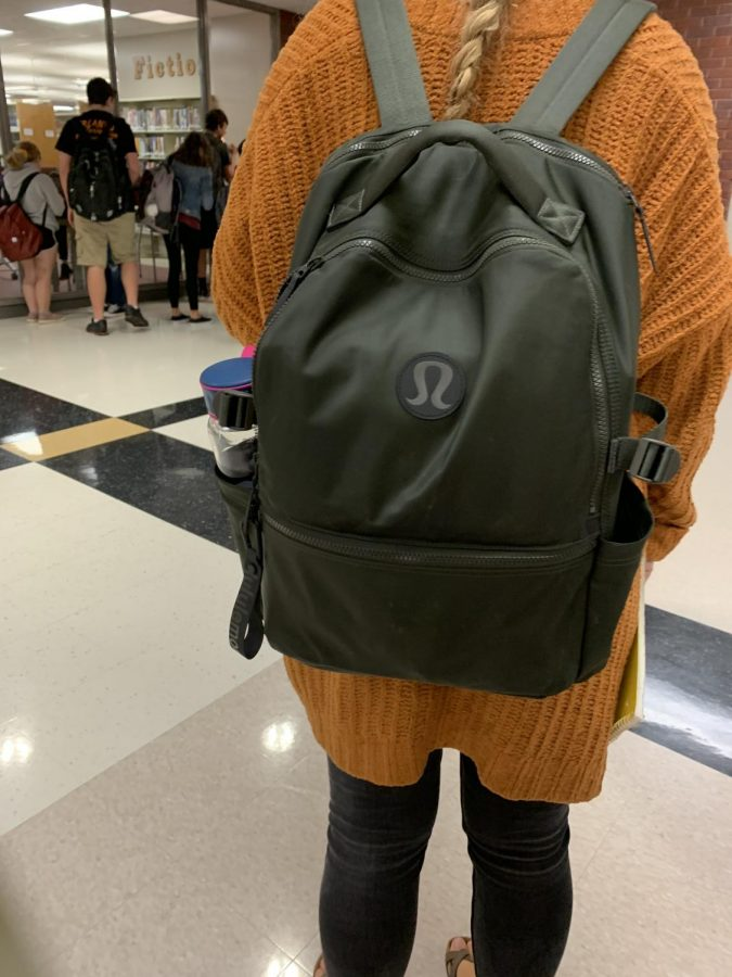 Junior Brenna Armstrong poses with her Lululemon backpack.
