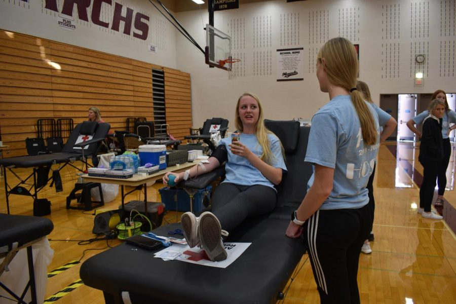Anna+Carlson+gets+her+blood+drawn+at+the+PLHS+HOSA+Blood+Drive.+The+Blood+Drive+is+hosted+by+the+Red+Cross+organization.