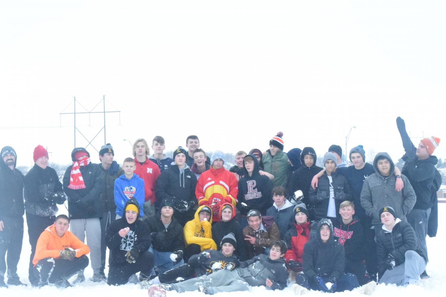The wrestling team enjoys a fun bonding day in the snow.