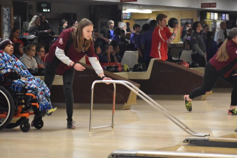Kaitlyn+Cox+puts+out+the+bowling+ramp+while+Jamie+Baquero-cruz+waits+eagerly+for+his+turn.