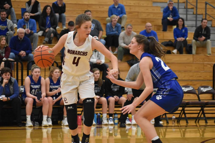 Junior+guard+Jenna+Hoelcher+dribbles+the+ball+against+Kearney+Thursday+night.+Hoelscher+had+five+points+and+seven+rebounds+in+the+Monarchs+win.