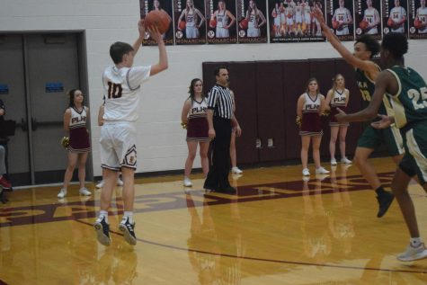Sophomore guard Keegan Hylok shoots a three against Bryan Tuesday night. Every Monarch got to play in this 35 point win