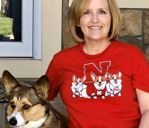 Herbener sits with her dog, Ollie. She is a UNL alum.