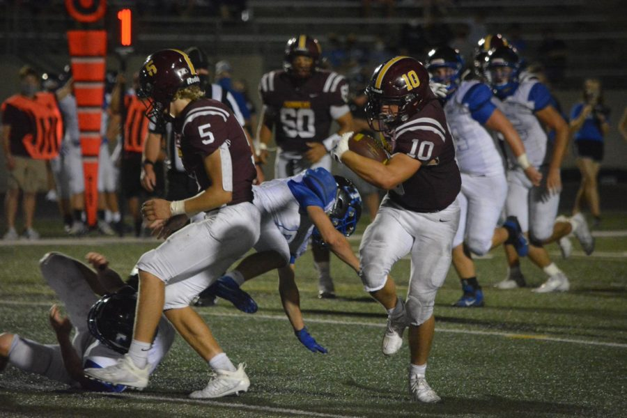 Senior running back Cole Price makes a man miss Friday night against Papio South. Price finished the game with 185 yards on the ground.