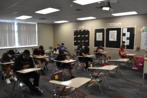 Freshman are working on writing assignment in Ms. Albertsons class.