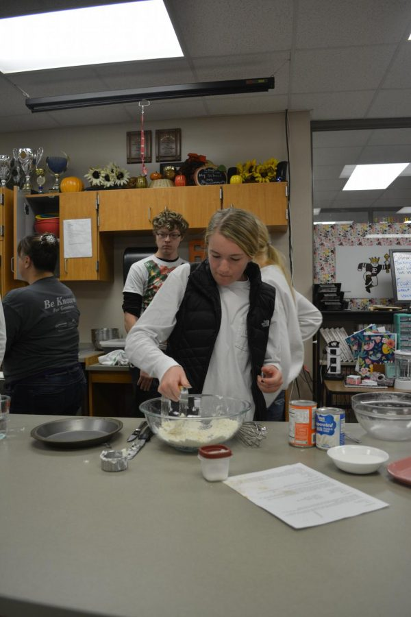 A student baking in Culinary Club. Many students have picked up cooking over quarantine.