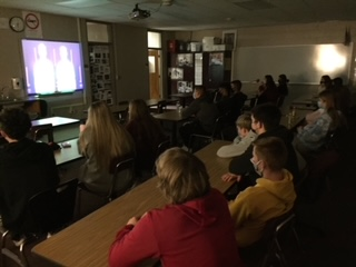Student athletes gather together to hear a message through a Zoom meeting for FCA
