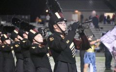 The marching band performs at halftime last season.