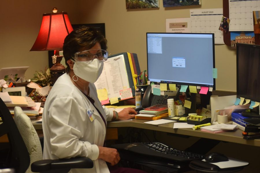 Nurse Jeanes works through the pandemic in her office.