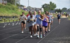 The girls cross country team during their timed mile at practice.