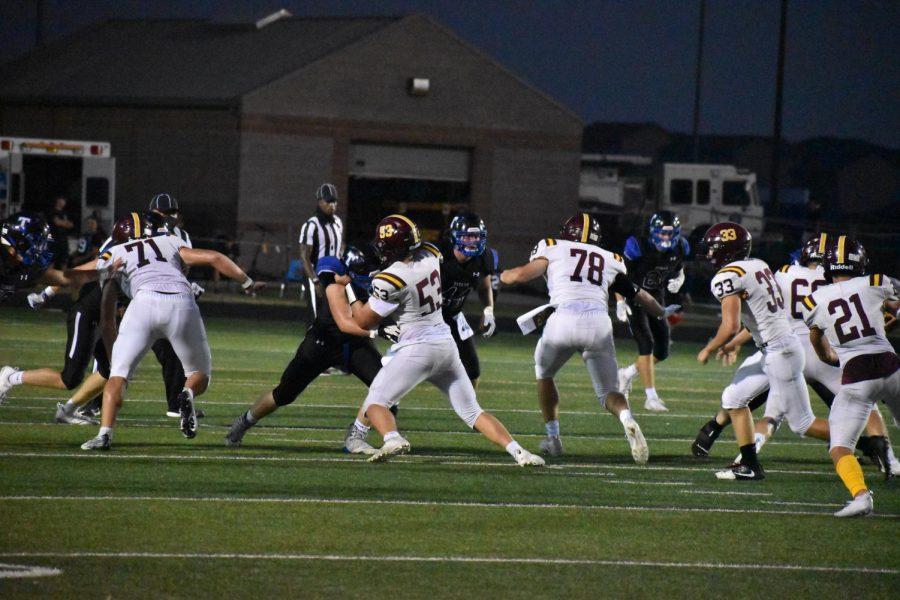 Senior offensive guard, Carson Vejvoda, blocks a Titans defender. Papio won 28-26 over their cross town rivals.