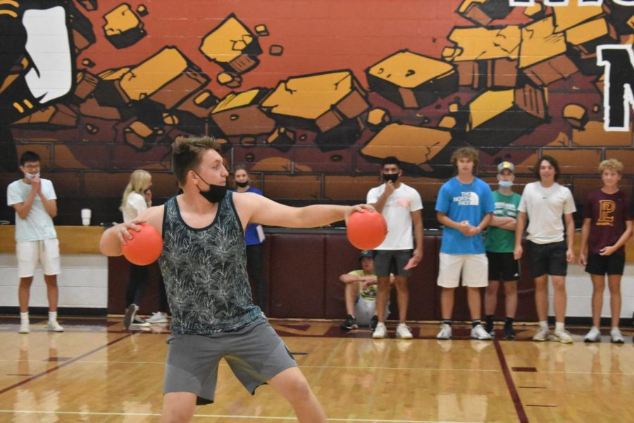 Junior Parker Wolfe aims to throw the dodgeball at the opposing team.